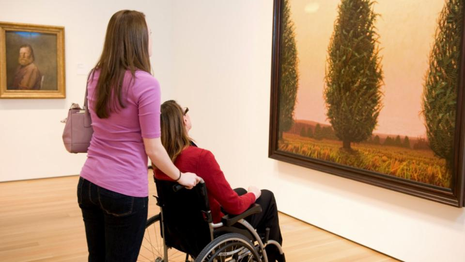 Image of people looking at painting