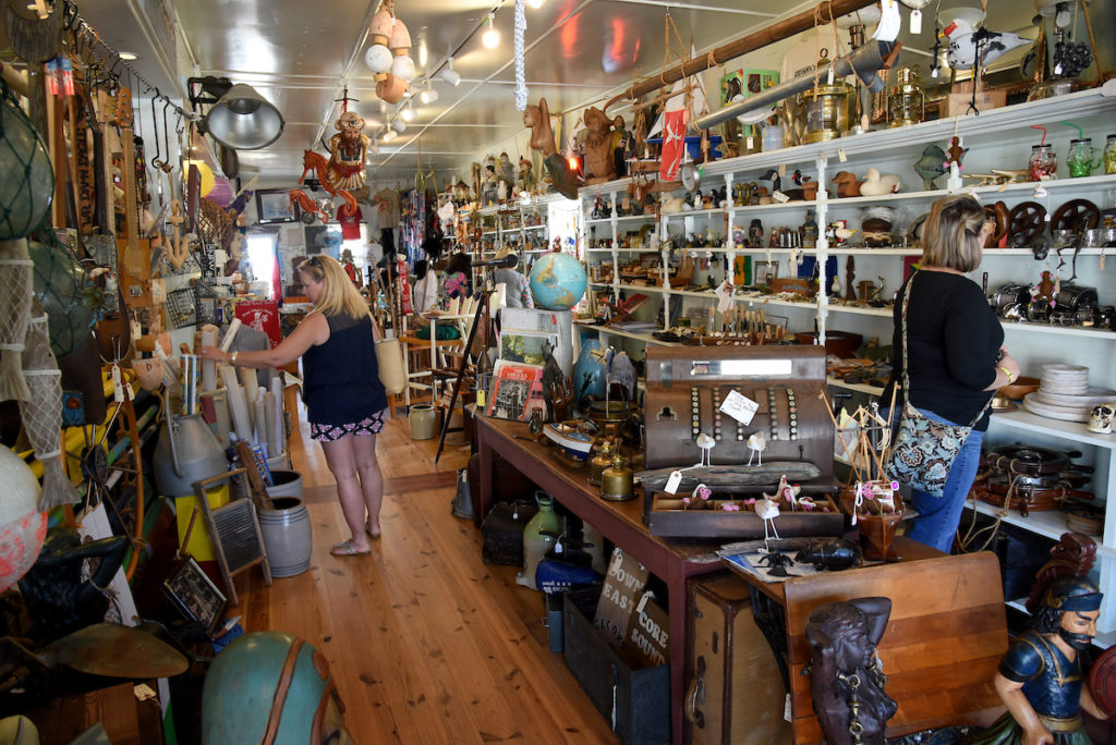 Shoppers peruse an antique store in Swansboro.